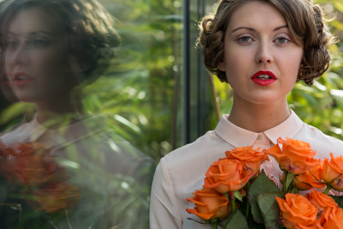 1930s inspired styling with orange roses